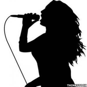 7f6512_woman_singing_into_microphone_in_silhouette_300